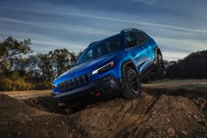 2020 Jeep Cherokee Trailhawk driving over rugged terrain