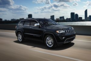2020 Jeep Grand Cherokee in black driving in the city