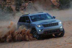 2020 Jeep Grand Cherokee drifting through sand