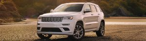 White 2020 Jeep Grand Cherokee parked