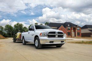 2020 Ram 1500 Classic white hauling a trailer