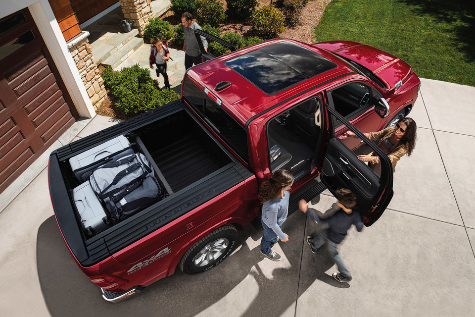 2020 Ram 1500 exterior top down view with doors open and family loading the truck