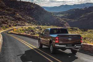 Ram 2500 driving, from behind, in the mountains