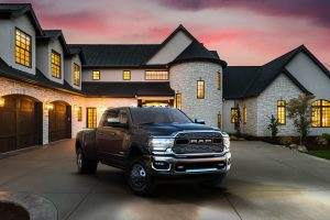 2020 Ram 3500 parked in front of a large house lit up