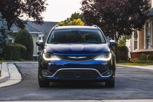 Front of 2020 Chrysler Pacifica in blue, parked in front of house