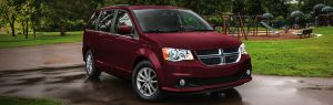 2020 Dodge Grand Caravan parked in front of a playground
