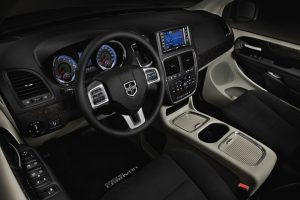 Front interior of 2020 Dodge Grand Caravan with steering wheel and dashboard