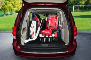 Rear of Dodge Grand Caravan open with hockey gear in the back