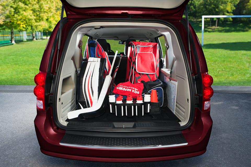 Rear of Dodge Grand Caravan open with hockey gear in the back