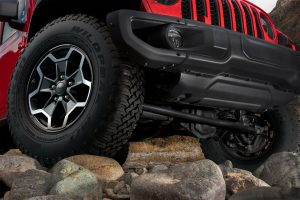Close-up of Jeep Gladiator wheels parked on rocks