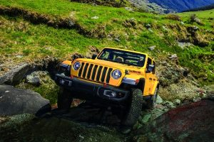 Jeep Wrangler driving over rocks