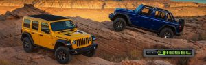 Two Jeep Wranglers parked in the desert with an EcoDiesel logo