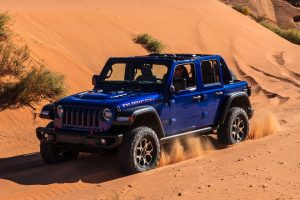 2020 blue Jeep Wrangler driving in the desert