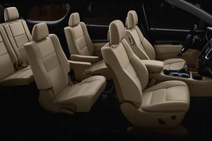 Side interior view of beige seats of 2020 Dodge Durango