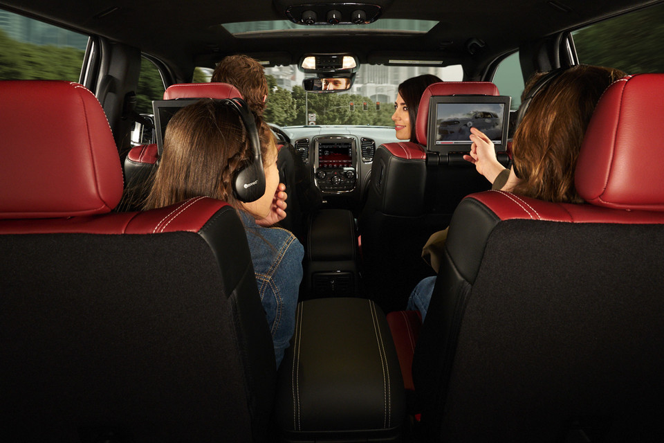 Interior from the back of kids watching the entertainment and parents in front seat of Dodge Durango