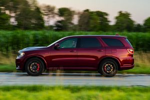 Side of 2020 Dodge Durango driving next to a field