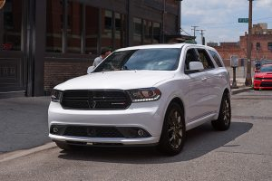 White Dodge Durango parked in the city