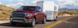 Ram 1500 Laramie pulling a trailer in the country