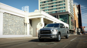 Ram 1500 Big Horn driving down a city street