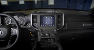 Front interior view of Ram 1500 with display screen in the middle