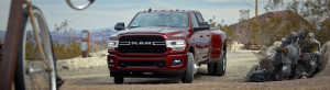 Front view of Ram 3500 Big Horn driving through a yard in the country