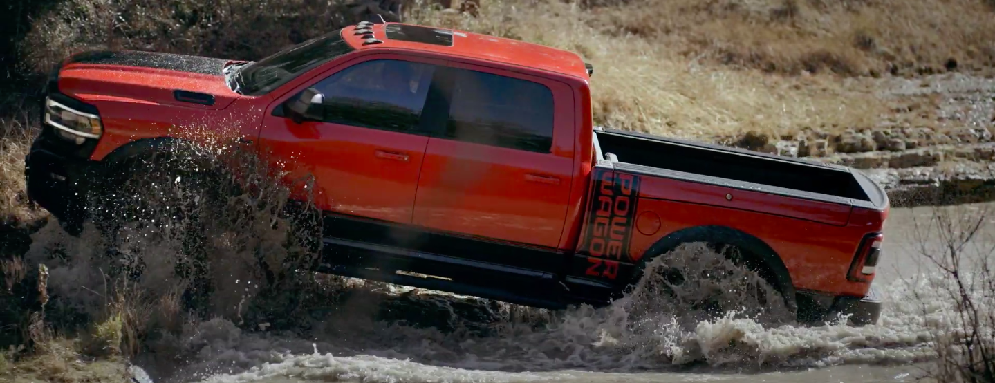 Side view of a 2020 Ram 2500 Power Wagon driving out of a bog