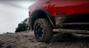 Close-up of Ram 2500 Power Wagon tire with mud splashed up on it